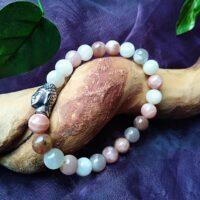 Bracelet  Pierre de Lune orangée perles 8mm et tête de Bouddha