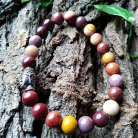 Bracelet  Mookaïte perles de 8mm et tête de Bouddha